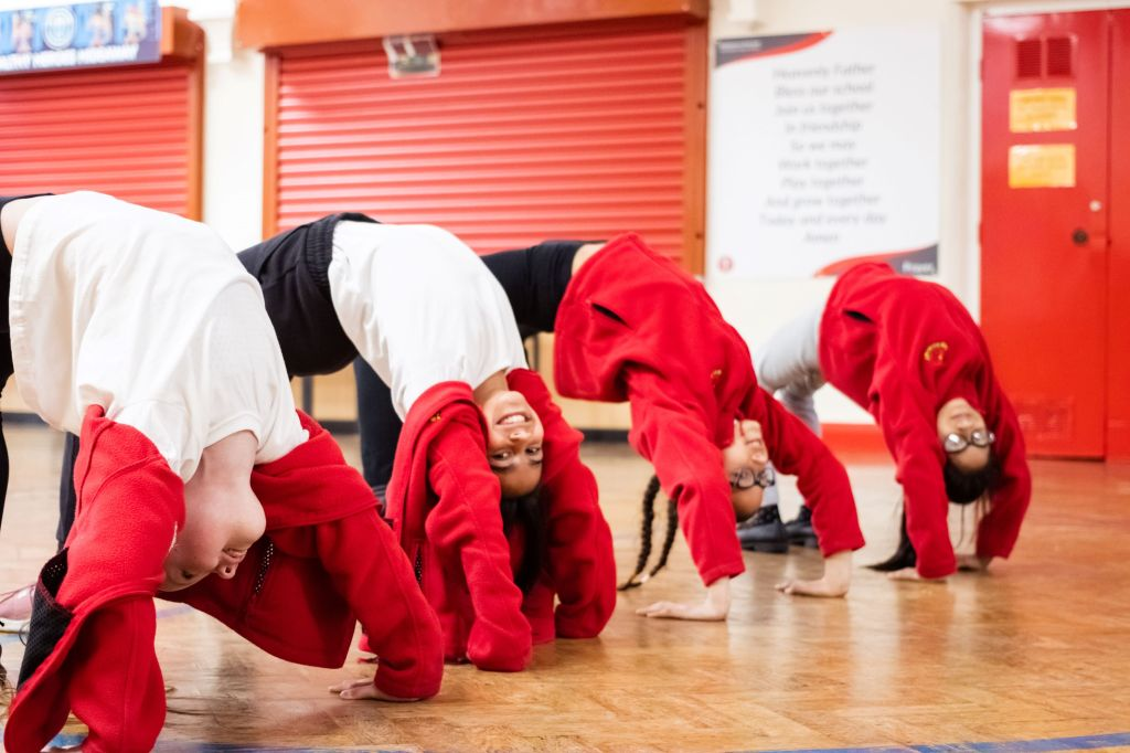 Primary school children doing a crab